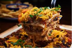 Spice up your festivities with this zesty lasagna. Enjoy this south of the border chorizo favorite! Mexican Lasagna Recipes, Mexican Dishes, Slow Cooker Recipes, Cooking Recipes, Smoked Sausage Recipes, Mexican Chorizo, One Skillet Meals, Good Food, Yummy Food