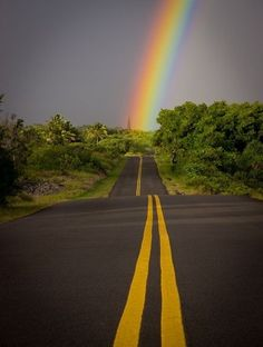 Beautiful rainbow at the end of the road.