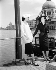 1951 - Christian Dior models in Venice - Sylvie in black &  Alla in Christian Dior's loose-fitting jacket with mandarin-collar sits in a gondola, Venice, June 1951