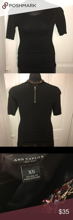 Ann Taylor Loft black Top with back gold zipper Ann Taylor Loft black Top with back gold zipper this shirt really complements your waist ! Great for a night out or in the work place Ann Taylor Tops Blouses