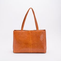 Morena in Amber Exotic. Carry your laptop, tablet, and smartphone inside. #betechchic #fallfashion #behobo