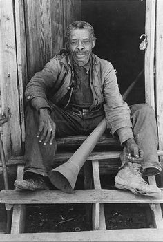 """1939  Former slave with horn used to call slaves, near Marshall, Texas."" Russell Lee."