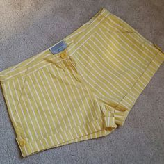 Anthropologie Miss Lili yellow striped shorts Like new, worn once or twice, no flaws or signs of wear. These cute lemon shorts are very lightweight and summery (100% cotton.) Both front and back pockets with cute buttons on each side. Tag reads size 7 and with a tape measure they are 32. Top to bottom length 11 in the front, 13 in the back. Inseam 3 inches. Anthropologie Shorts