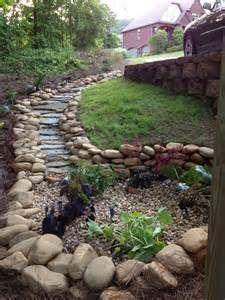 The dry creek bed that ends into a rain garden. I designed and built ...