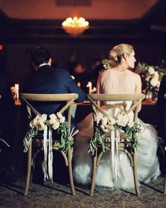 Bride and Groom chair accents. #garlands #chairaccents