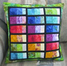 Freemotion by the River: Stacked Rainbow tutorial This is a pillow that I made using the Light & Bright Batik Stack that I had bought last month. I wanted to get an idea of how I wanted to use the colors when my Fat Quarter Sampler came. A stack is 10 inch squares of 24 different batiks.