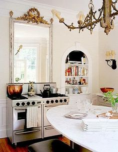 Mirror over the kitchen sink is a great way to a) make room bigger, b) include person in front of sink with rest of room.