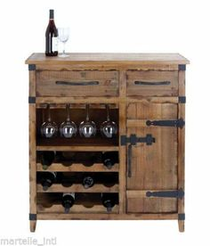 Weathered wood wine cabinet with two drawers and a side door. Includes one glass rack and three bottom racks fotwelve bottles. Product: Wine cabinetConstruction Material: WoodColor: NaturalFeatures: Two drawersHolds up to 12 bottles Dimensions: H x W x D Wine Hutch, Wine Rack Cabinet, Liquor Cabinet, Rustic Wine Cabinet, Rustic Wine Racks, Cabinet Storage, Home Bar Furniture, Accent Furniture, Furniture Showroom