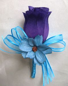boutonniere( minus the teal flower like for the guys n maybe lavender colored rose)