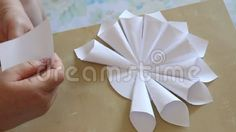 Paper flower handmade - handmade paper cones and then glued circular.