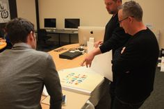 Nathan Scoular of Billy Blue College of Design and Andrew Ashton reviewing a project with Ray Parslow.