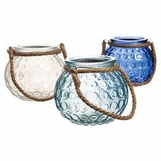 """Bring artful appeal to your mantel or console table with this charming blue candleholder, crafted from glass and featuring a rope accent.  Product: Small, medium and large candleholderConstruction Material: Glass and ropeColor: BlueDimensions: 3.35"""" H x 4.13"""" Diameter each"""