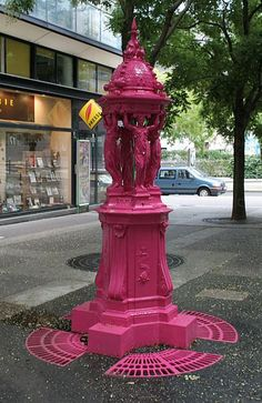 Pink Wallace fountain (public drinking fountain), rue Jean-Anouilh, Paris.