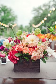 wooden box floral inspiration. this would be HIGH end $$$ ( this would be a good choice for family tables)