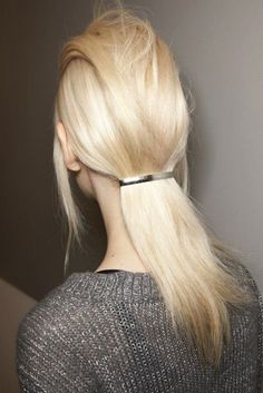Low flat ponytail.