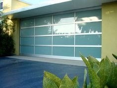 Hmmm, for my fantasy garage? Here's a great source for sandblasted glass and aluminum garage doors for instant update/back date of mid century exterior. Garage Door Colors, Glass Garage Door, Garage Door Design, Glass Door, Contemporary Garage Doors, Modern Garage Doors, Garage Entry, Contemporary Houses, Entry Doors