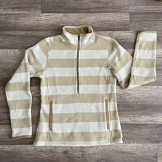 Gently used Patagonia Striped tan (Pale khaki) better sweater quarter zip fleece pullover in a women's size small. Good condition with some minor pilling in typical places (hem; arm cuffs.) lots and lots of life left! Price is firm. *please note: comes from a smoke free pet friendly home* Patagonia Fleece Jacket, Arm Cuffs, Cool Sweaters, Smoke Free, Pullover, Zip, Note, Hoodies, Places