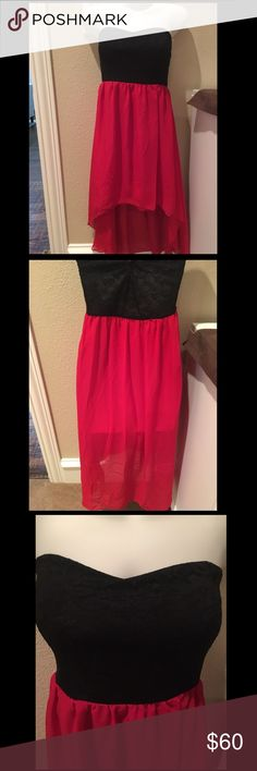 ONLY 2 left! High/low black and red dress. Gorgeous for the holidays. High/Low red and black dress. The bottom half is chiffon and lace around the bust area. This is 100% Polyester. NWOT Dresses Mini