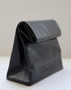 Black leather fold down bag