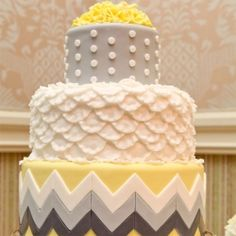 We love the combination of textures, patterns, and colors on this cake! Pretty for Grey and yellow.