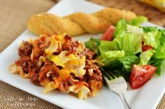 1 pound lean ground beef 1 (15 ounce) can Tomato sauce 1 (8 ounce) can Tomato sauce 1/2 teaspoon salt 1/2 teaspoon black pepper 8 ounces Egg...