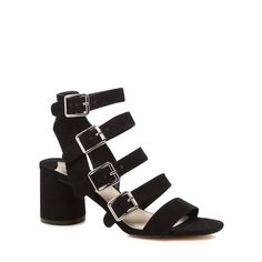 These sandals from our Faith collection are perfect for transitioning from day-to-evening with effortless style. Lifted by a cylindrical block heel, this pair encases the foot in soft suedette straps that are complemented with silver-toned metal buckles.
