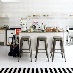 Modern and fresh kitchen. How I love Tolix stools...