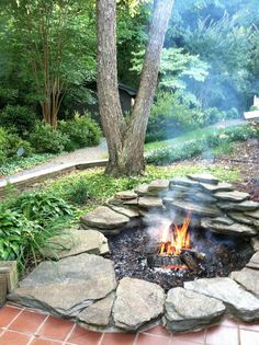 fire pit transformed from a Koi pond