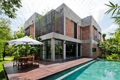Vietnamese studio MM++ Architects stripped a house back to its concrete frame to create this pared-back open-plan villa featuring red brick walls, pivoting glass doors and leafy gardens. Architecture Résidentielle, Amazing Architecture, Contemporary Architecture, House Seasons, Design Exterior, Red Brick Walls, Tropical Houses, Home Fashion, Beautiful Homes