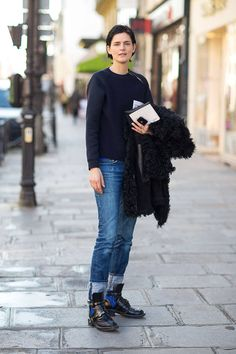 pullover, cuffed jeans, combat boots and furry coat