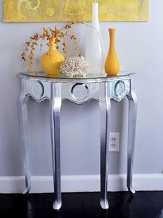 Clair de (Demi)Lune; Sand and prime the table, then brush the legs and the beveled edges of the tabletop with silver leaf and seal them with polyurethane. Trace a kraft paper pattern of the curvy tabletop, then have 1/4-inch mirror cut to fit