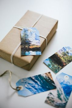 I really like the idea of these gift tags.  Though the link is for a free download of these specific designs, you could use your own photographs and make gift tags out of them!  They could even be themed: think vintage Christmas or family photos.  I do love the way the natural landscapes look here, contrasted against the simple brown wrapping paper and twine.