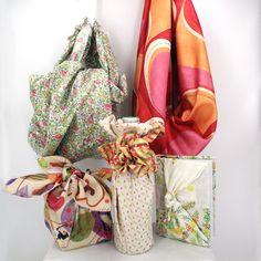 """Es ist eine Tasche. Es sit ein Geschenk. Es ist ein Bucheinband. Es ist einzigartig. Es ist ein TUCH!  Furushiki - die Kunst des Umhüllens mit Stofftüchern. Unter dem Motto """"reduce, reuse, recycle"""" leben die Japaner schon seit Jahrhunderten. Mit wachsenden Umweltbewusstsein erobert diese Kunstform die ganze Welt.  buntherum steht für achtsames Kaufen und kreatives Schenken!"""