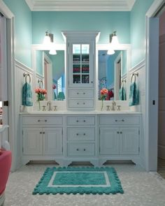 We are swooning over the moon for this luxurious guest bathroom so on trend for 2017 and beyond! High cabinetry with on Trend plumbing, bead board and crown molding. A gorgeous shade of turquoise with a matching accents and how about that Geo metric floor? Your guest will know that you care and this is a great feature for your home!#Farmhouse #FarmhouseStyle #FarmhouseBathroom #CozyCottage #Cottage #LuxuryHome #LuxuryLifestyle #PowderRoom #GuestBath #JackAndJillBath #TurquoisePaint #Real esta...