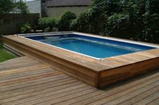 Wood Decks around Swimming Pools | advantages disadvantages a raised deck can eliminate the need for