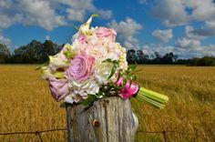 Soft pink roses, white calla lilies, hydrangeas.
