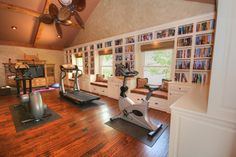 I don't like the design of this room, but I do like the concept of a library/home gym room with window seats.