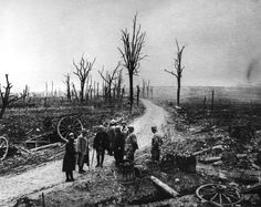 WWI, Dec 1916; Soldiers watching skeletal trees ruins and rubble at the end of the Battle of Verdun.
