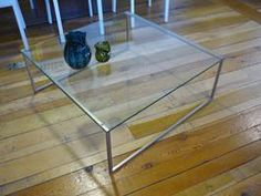 Occa 1079 Coffee Table Save £150 Now £149 Was £299 Occa 1079 Coffee Table  Clear Glass/Brushed Steel  H40xW91.5x91.5cm