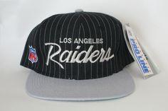 Vintage Los Angeles Raiders NFL pinstripe snapback hat made by Sports  Specialties bfced0f5ea91