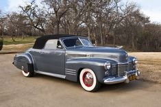 1941 Cadillac Series 62 Convertible Coupe. love that gun metal color with the red in the wheels.