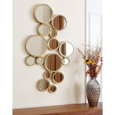 Add fun to your living space with the Abbyson Living wall mirror featured in a bubble design. Trimmed in gold accents, the circular glass is shaped in a variety of different sizes to finish this decorative piece.