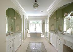 Interesting floor design, marble and chrome, soaking tub...