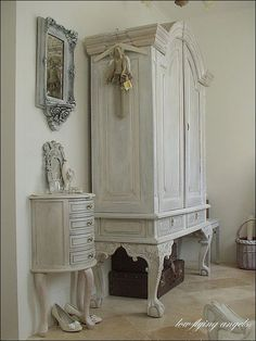 beautiful! From the low flying angels blog....library table with a cabinet top attached....painted to look as one..