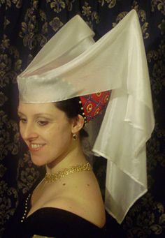 Butterfly hennin, Red Silk encrusted in Goldwork and embroidery, with Pearls and Jewels with a fine Silk Veil