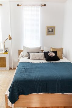 """Our Style Editor's Small-Space Makeover Shows Us How It's Done #refinery29  http://www.refinery29.com/small-nyc-apartment-makeover#slide9  After:  For the bed, Kelley mixed in various small-scale patterns in the same palette and a textured, gold pillow. """"By replacing the duvet with layered textiles, the whole look became instantly more sophisticated."""""""