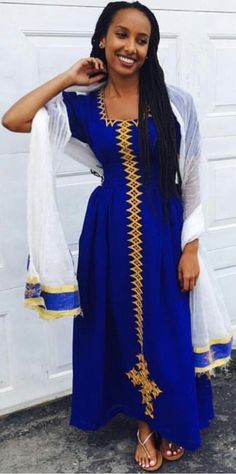 Beautiful habesha, Ethiopian fashion is something i really like, that blue shade <3