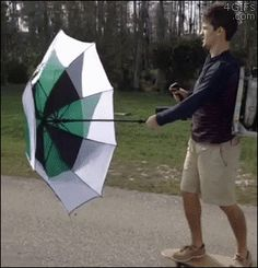 Skateboarding with an umbrella and a leaf blower. Problem?