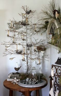 52 FLEA: A Peek At The Enchanted Winter Nest .click through for gorgeous photos of farmhouse holiday decorating ideas. // bit of greens on wall, tiny birds & nests, barely decorated tree (twigs would work too) perfect Moment . Big Christmas Tree, Simple Christmas, Christmas Holidays, Christmas Crafts, Christmas Decorations, Christmas Skirt, Holiday Decorating, White Christmas, Tree Decorations