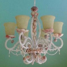 Shell embellished chandelier for a beach house